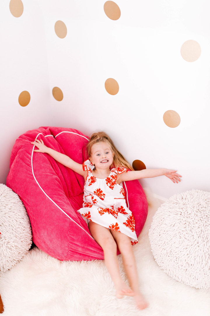 Eva Amurri Martino's daughter Marlowe makes a silly face on a colorful bean bag chair
