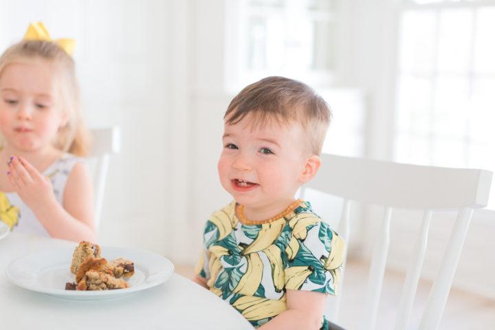 Eva Amurri Martino's son Major smiles with a slice of dairy free banana bread