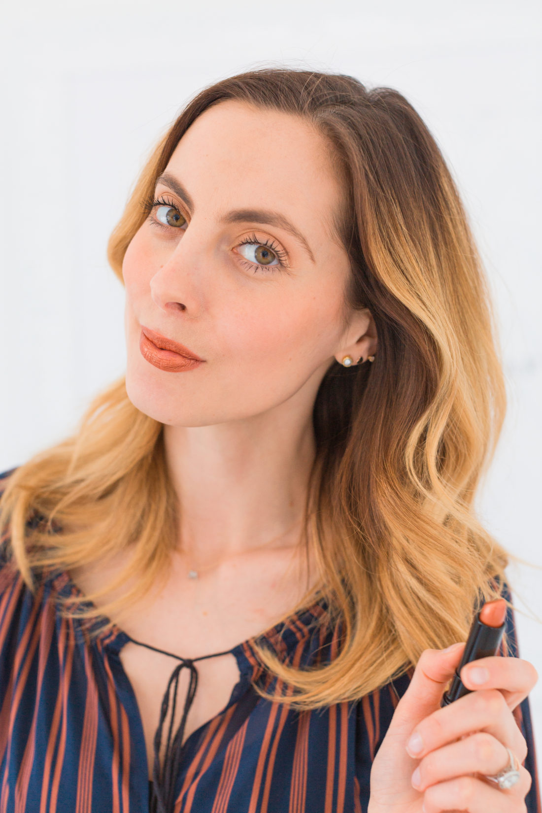 Eva Amurri Martino wears a coppery metallic lipstick as part of her monthly obsessions roundup