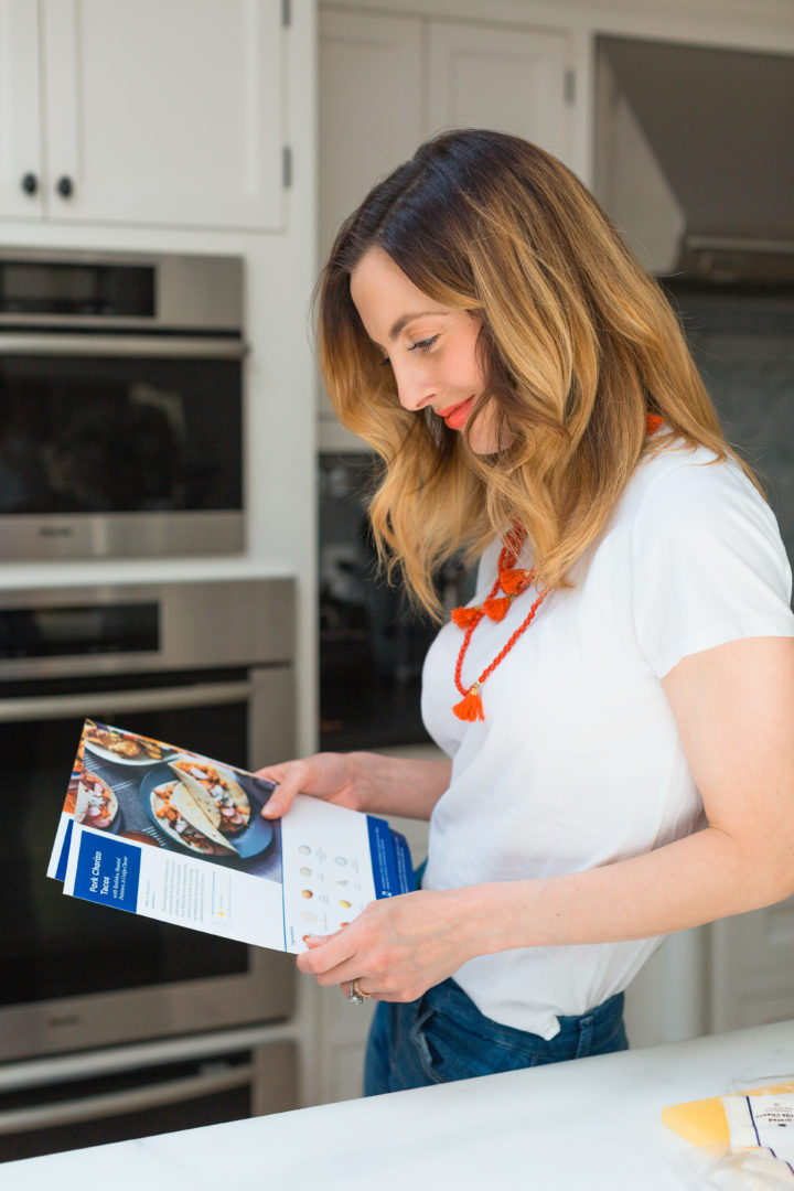 Eva Amurri Martino reads Blue Apron recipe cards.
