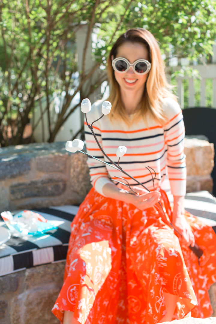 Eva Amurri Martino roasts smores in a colorful frock at her Connecticut home