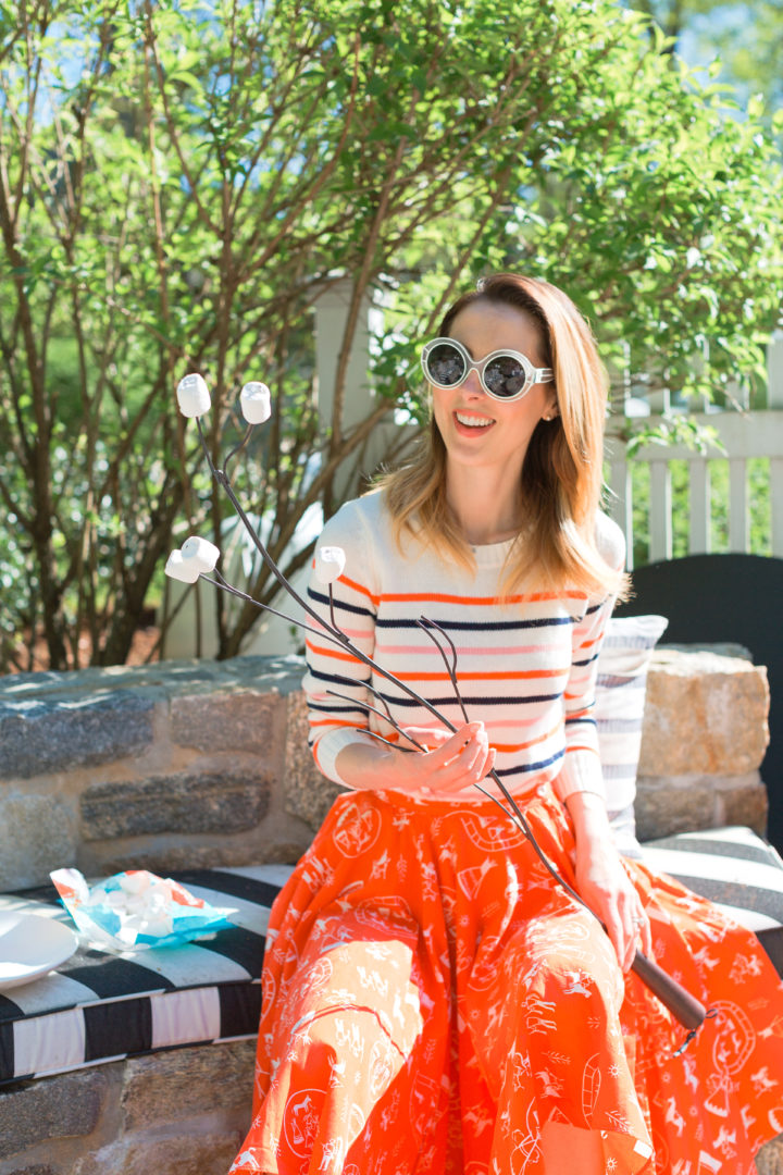 Eva Amurri Martino roasts marshmallows in a colorful frock at her Connecticut home