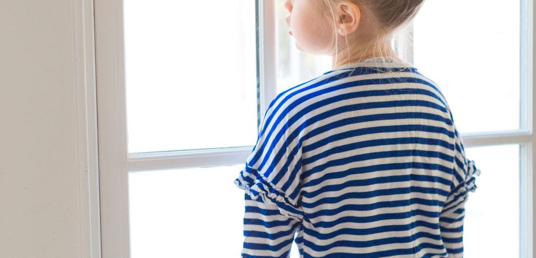 Eva Amurri Martino's daughter Marlowe looks longingly out the window of their Connecticut home
