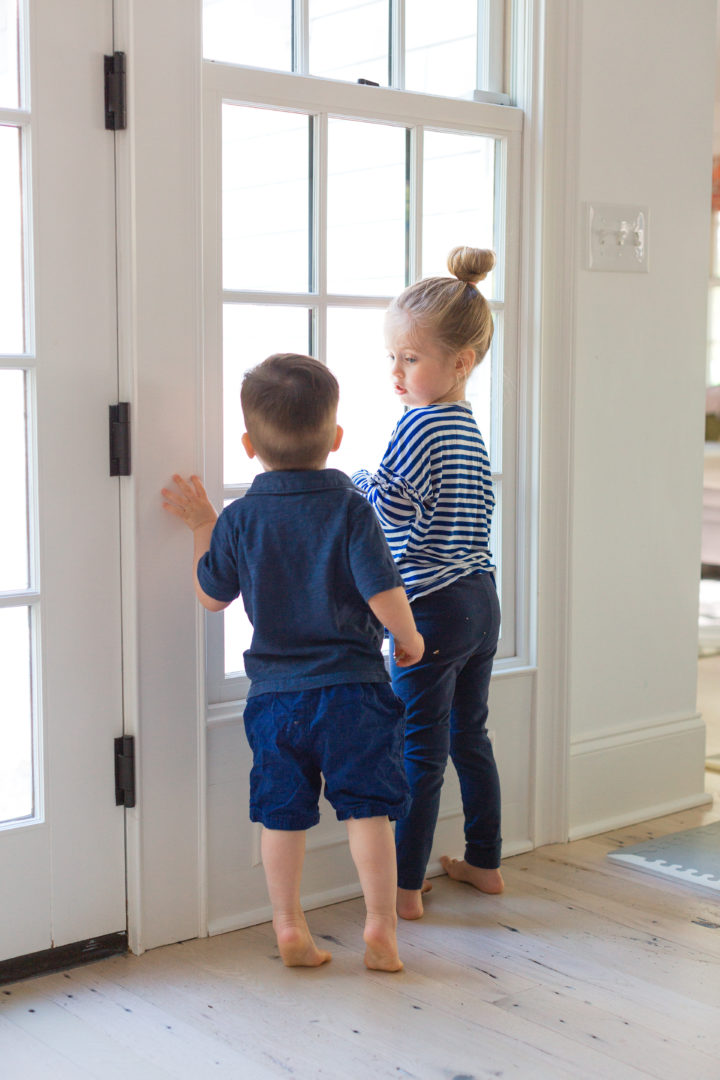 Eva Amurri Martino's children Marlowe and Major look out the window of their Connecticut home