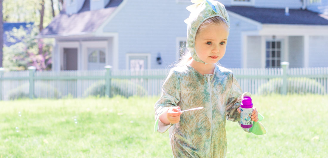 Eva Amurri Martino's daughter Marlowe wars a dinosaur costume and carries bubbles