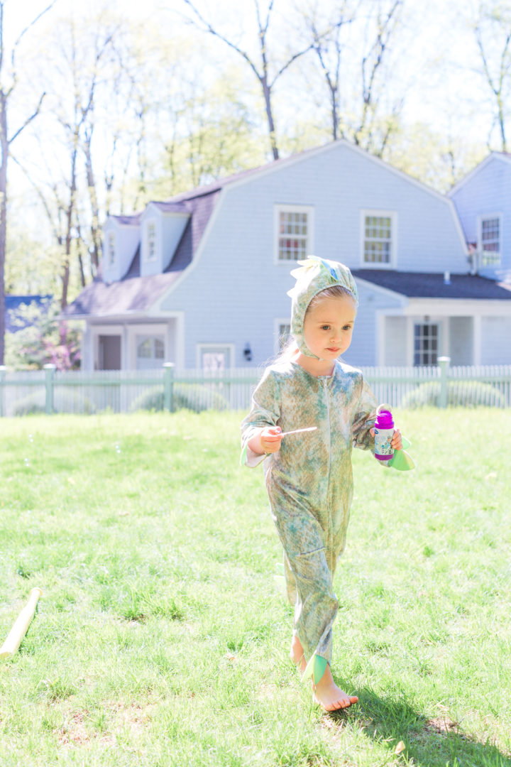 Eva Amurri Martino's daughter Marlowe wars a dinosaur costume and carries bubbles