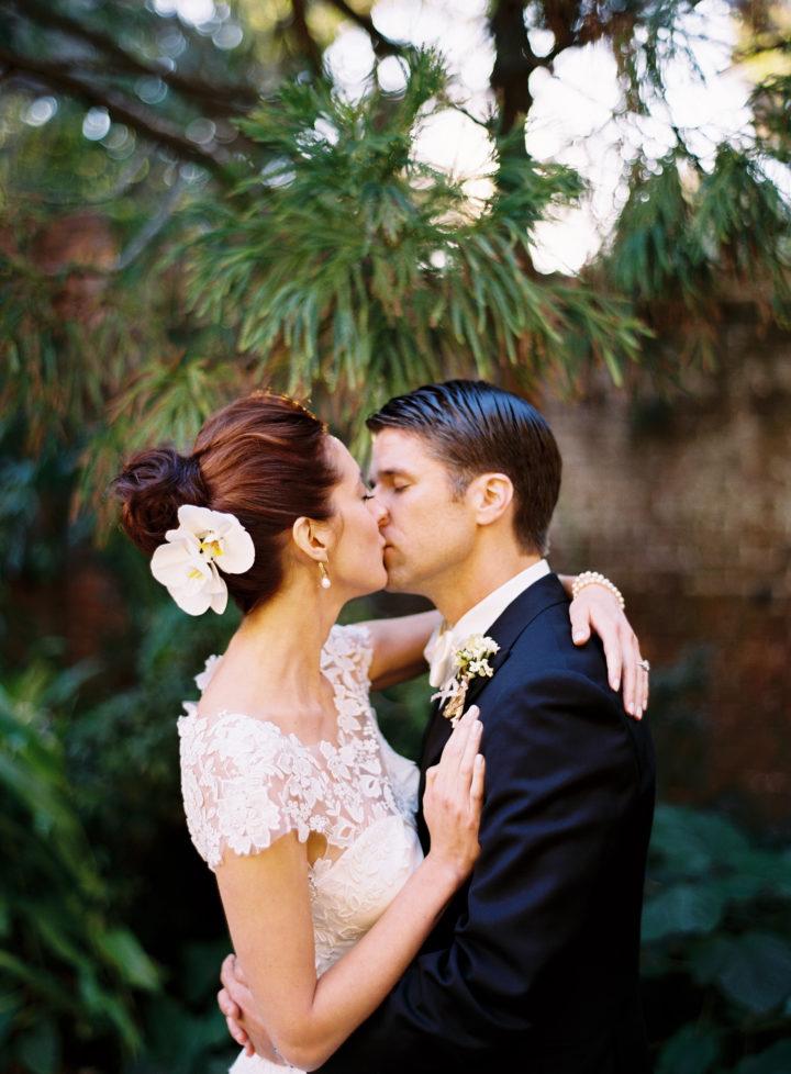 Kyle and Eva Martino kiss sweetly at their Charleston wedding