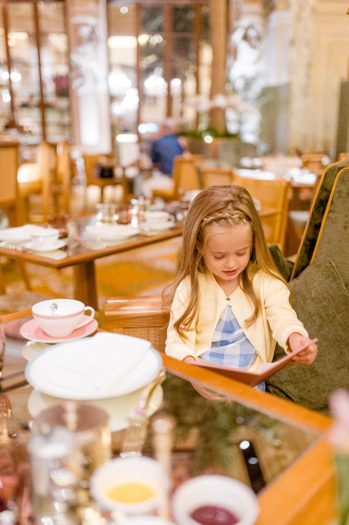 Eva Amurri Martino's daughter Marlowe mulls over the menu at the iconic Plaza Hotel in New York City