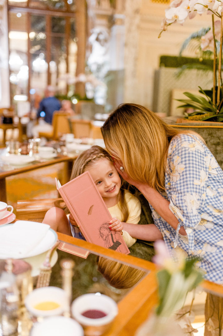 Eva Amurri Martino and her daughter Marlowe mull over the menu at the iconic Plaza Hotel in New York City