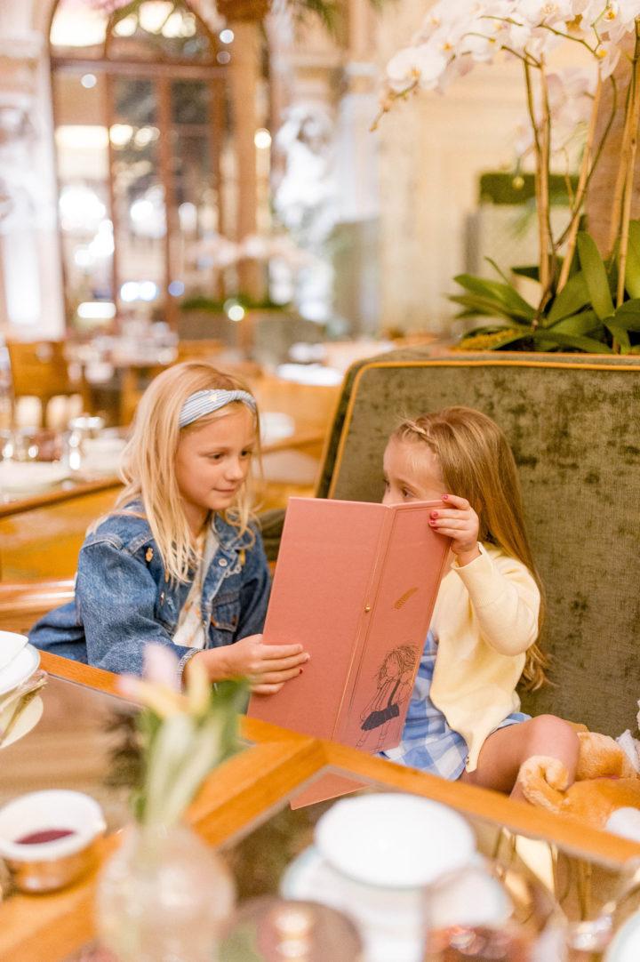 Eva Amurri Martino's daughter Marlowe looks at the menu at the Plaza Hotel in New York City