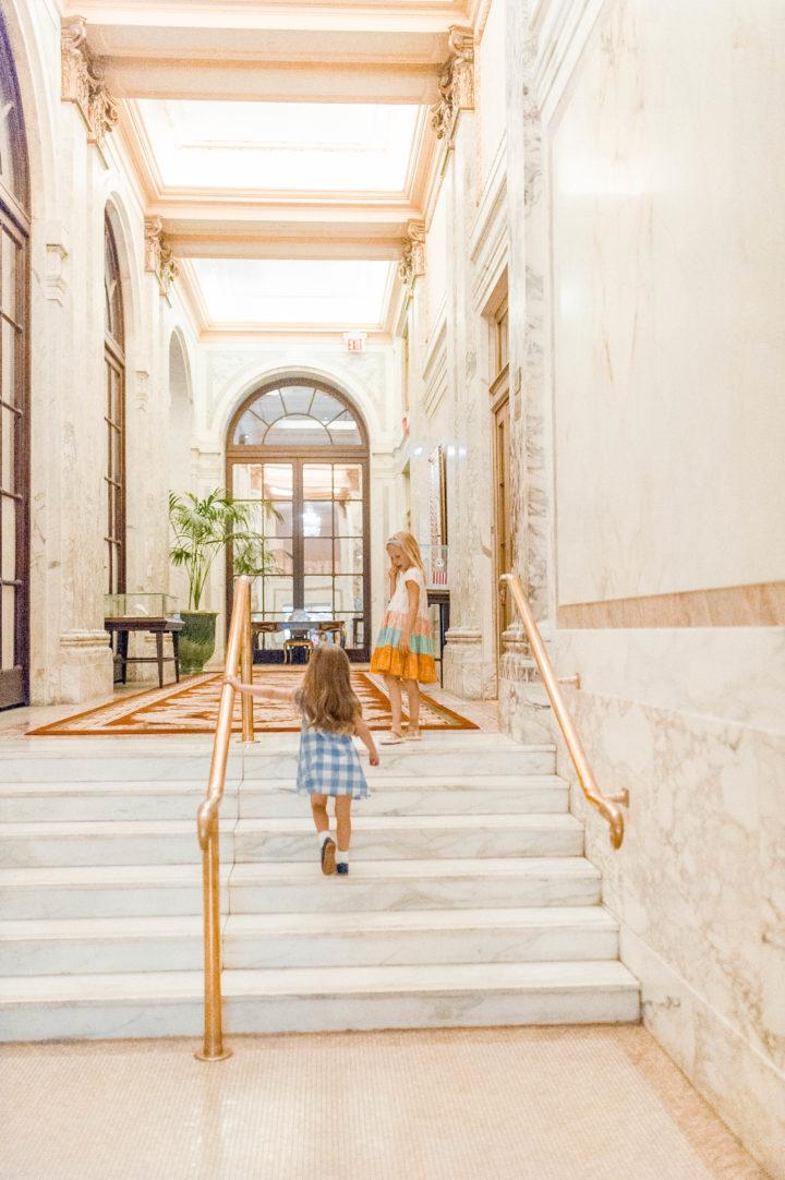 Eva Amurri Martino's daughter Marlowe walks through the lobby of the Plaza Hotel in New York City