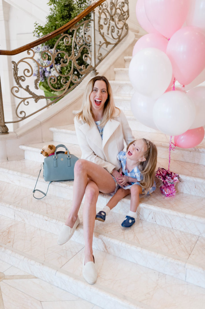 Eva Amurri poses with her daughter Marlowe on marble steps with pink and white balloons at the Plaza Hotel in New York City
