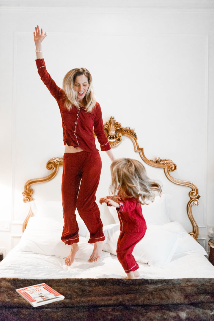Eva Amurri Martino jumps on the bed at the Plaza Hotel in New York City with her daughter Marlowe