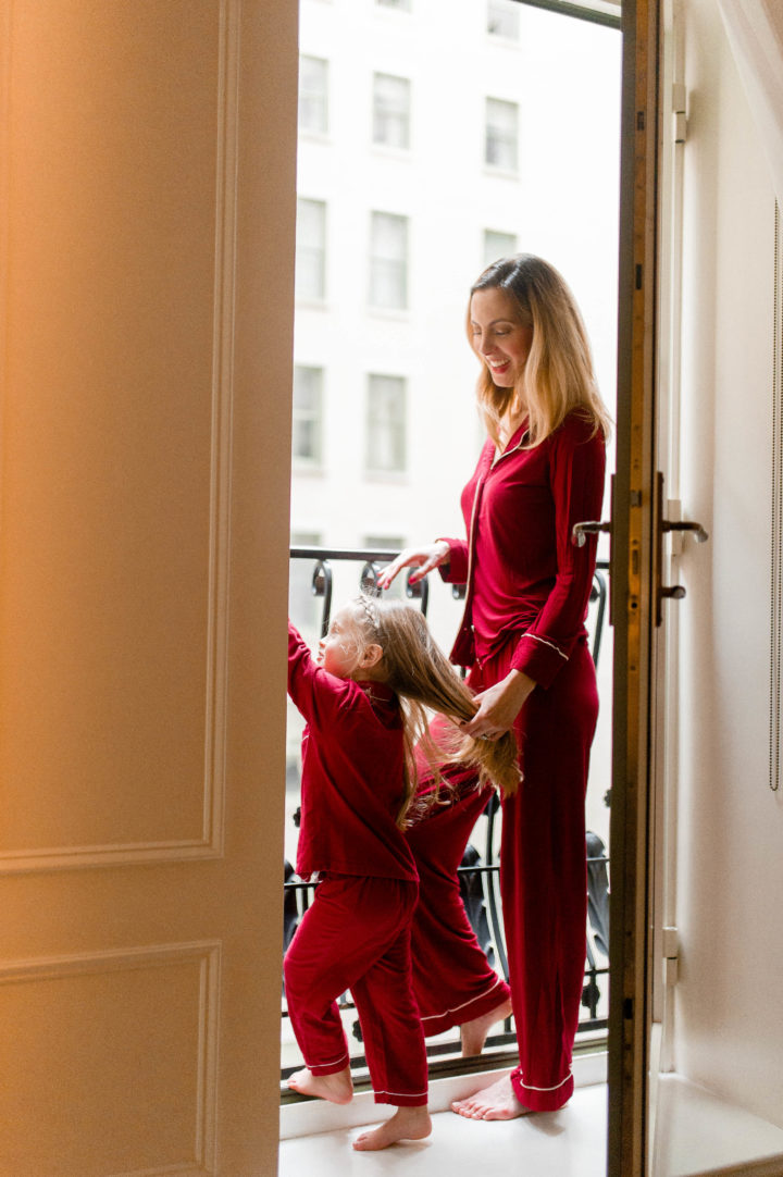 Eva Amurri Martino looks at the window of her room at the Plaza Hotel with her daughter Marlowe