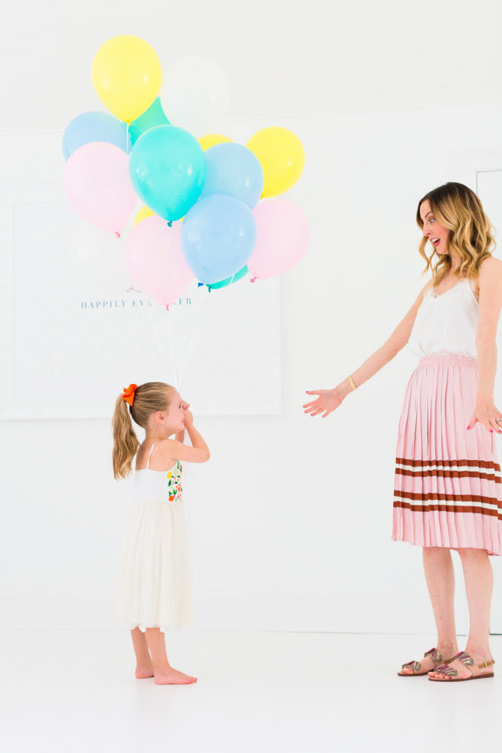 Eva Amurri Martino throws her hands in the air to celebrate the 3rd birthday of her blog Happily Eva After