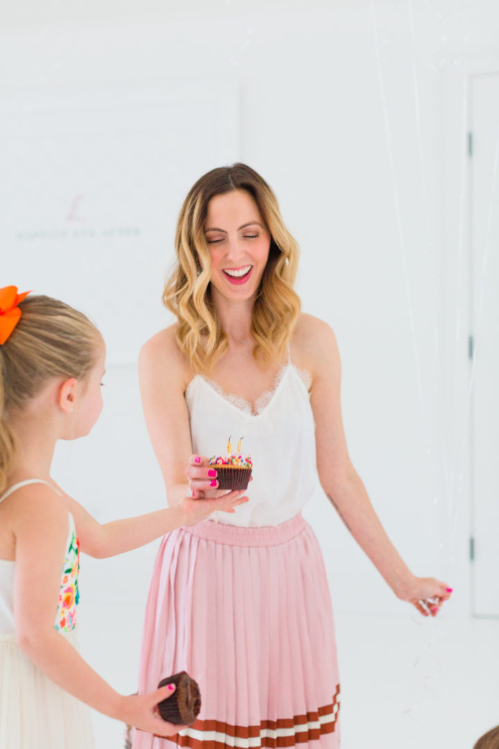 Eva Amurri Martino blows out a candle on a cupcake with her daughter Marlowe to celebrate her blog Happily Eva After's 3rd birthday
