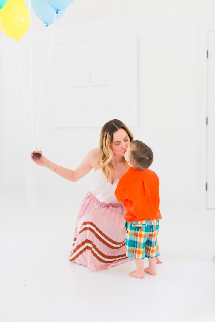 Eva Amurri Martino sweetly kisses her son Major while they both enjoy cupcakes to celebrate the 3rd birthday of her blog Happily Eva After