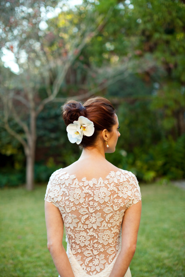 The beautiful details on the back of Eva Amurri Marino's wedding dress, which she paired with white flowers in her updo.