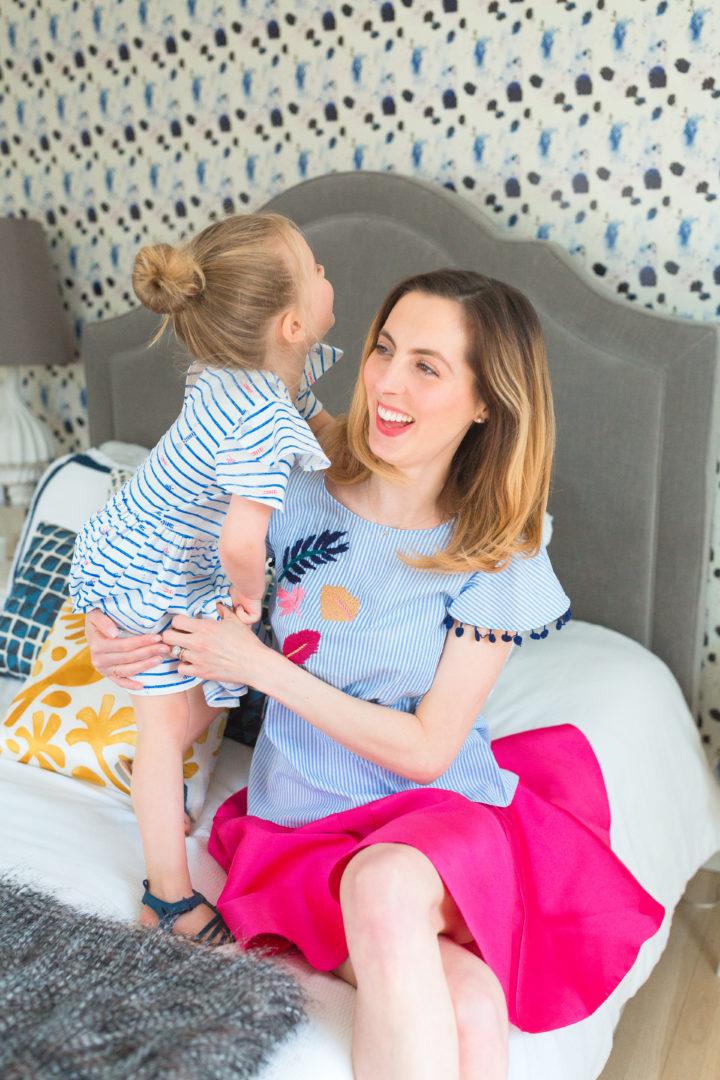Eva Amurri Martino wears a bright pink skirt with her daughter Marlowe