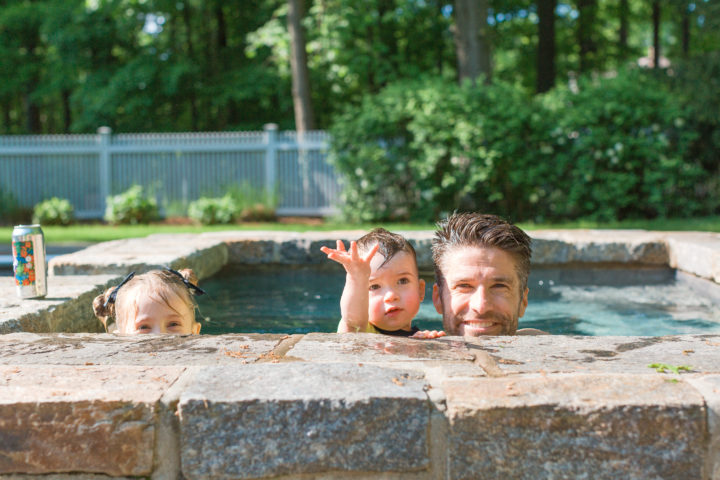 Kyle Martino plays with his daughter Marlowe and son Major in the pool