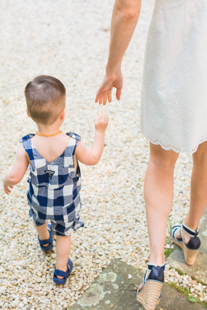 Eva Amurri Martino reaches for her son Major's hand.