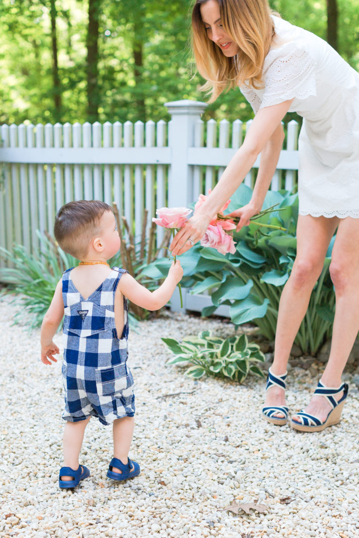 Eva Amurri Martino hands her son Major a flower from their garden in Connecticut.