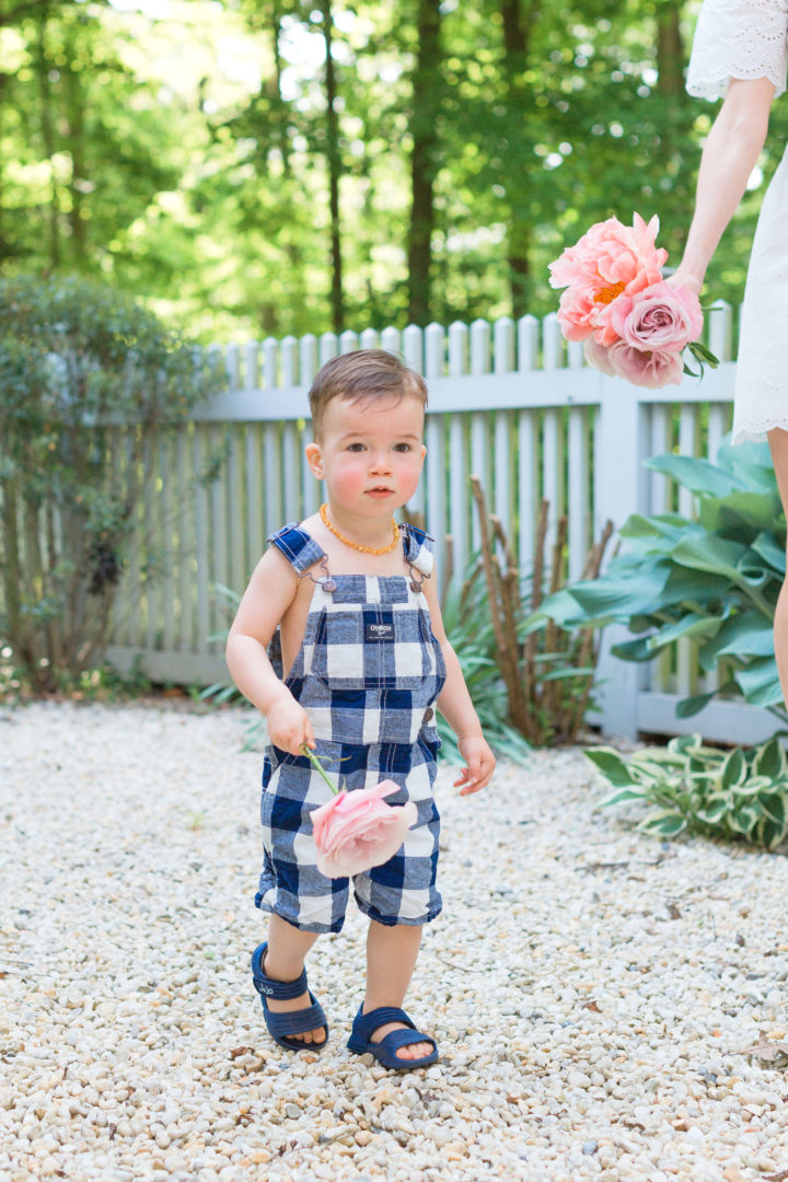 Eva Amurri Martino's son Major carries flowers from their garden in Connecticut.