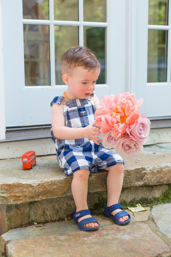Eva Amurri Martino's son Major sit on a set with fresh cut flowers from their garden in Connecticut.