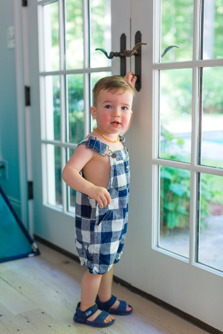 Eva Amurri Martino's son Major poses in gingham overalls in their house in Connecticut.