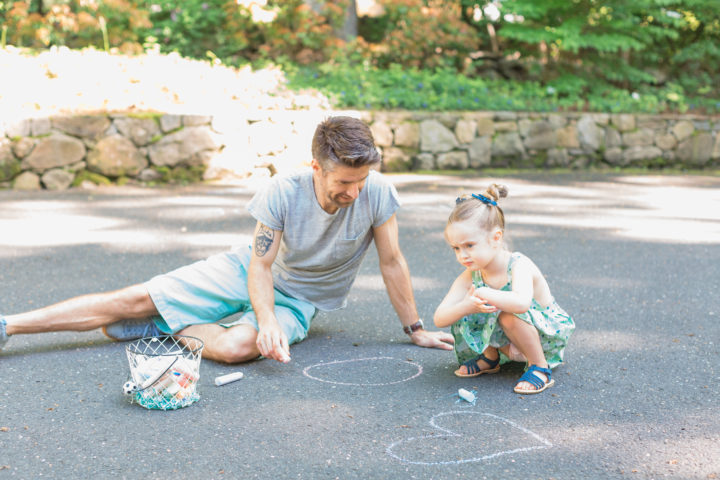Kyle Martino and his daughter Marlowe draw with chalk in the driveway of their Connecticut home.