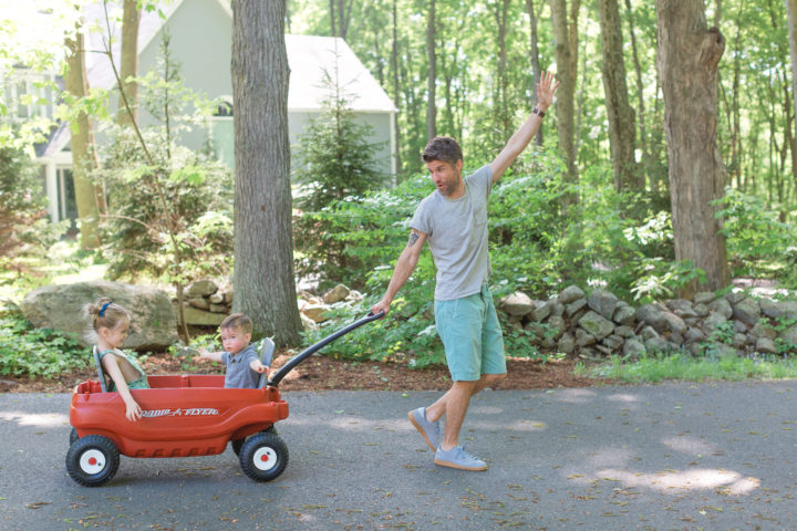Kyle Martino pulls his kids Marlowe and Major in a wagon on their property in Connecticut