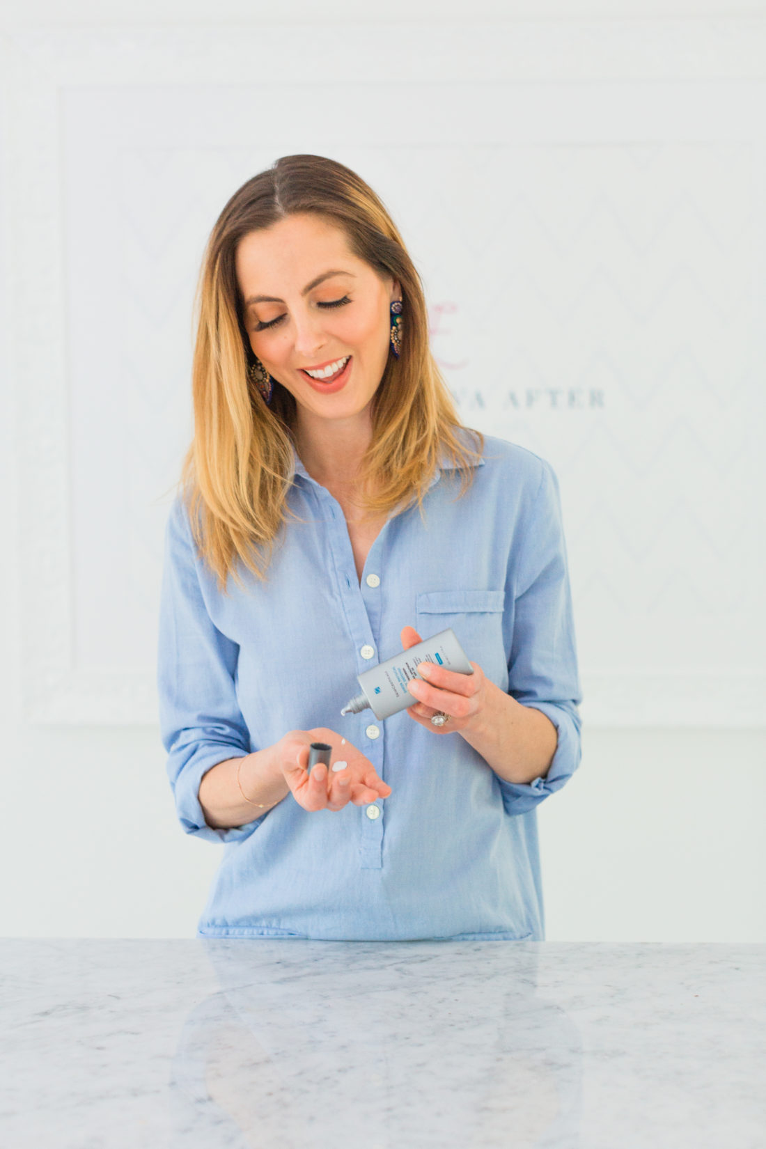 Eva Amurri Martino applies sheer sunscreen as part of her monthly obsessions roundup