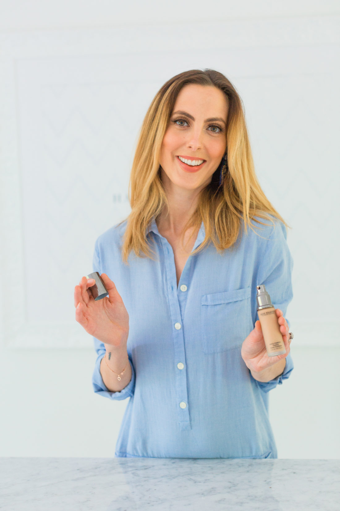 Eva Amurri Martino applies Juice Beauty serum foundation as part of her monthly obessions roundup