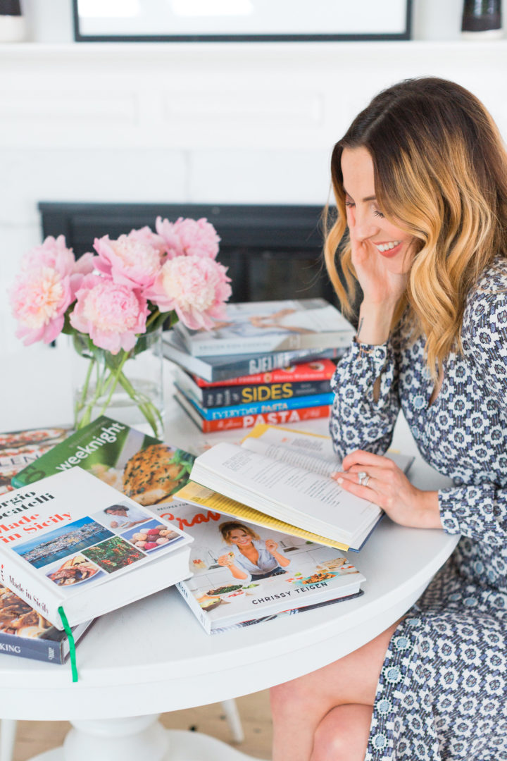 Eva Amurri Martino sits in her Connecticut home with a pile of her favorite cookbooks