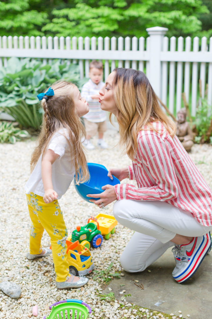 Eva Amurri Martino kisses her daugter Marlowe in the yard of their Connecticut home.