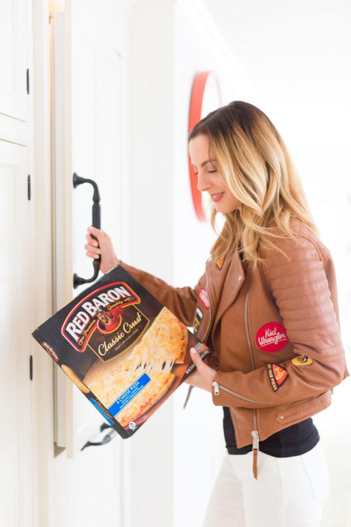 Eva Amurri Martino grabs a Red Baron pizza from the freezer