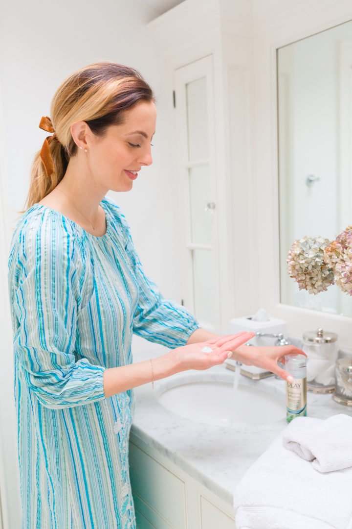 Eva Amurri Martino squeezes out some Olay into her hands before she cleanses her face.
