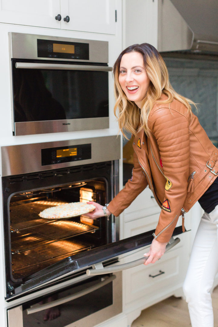 Eva Amurri Martino puts a Red Baron pizza in the oven