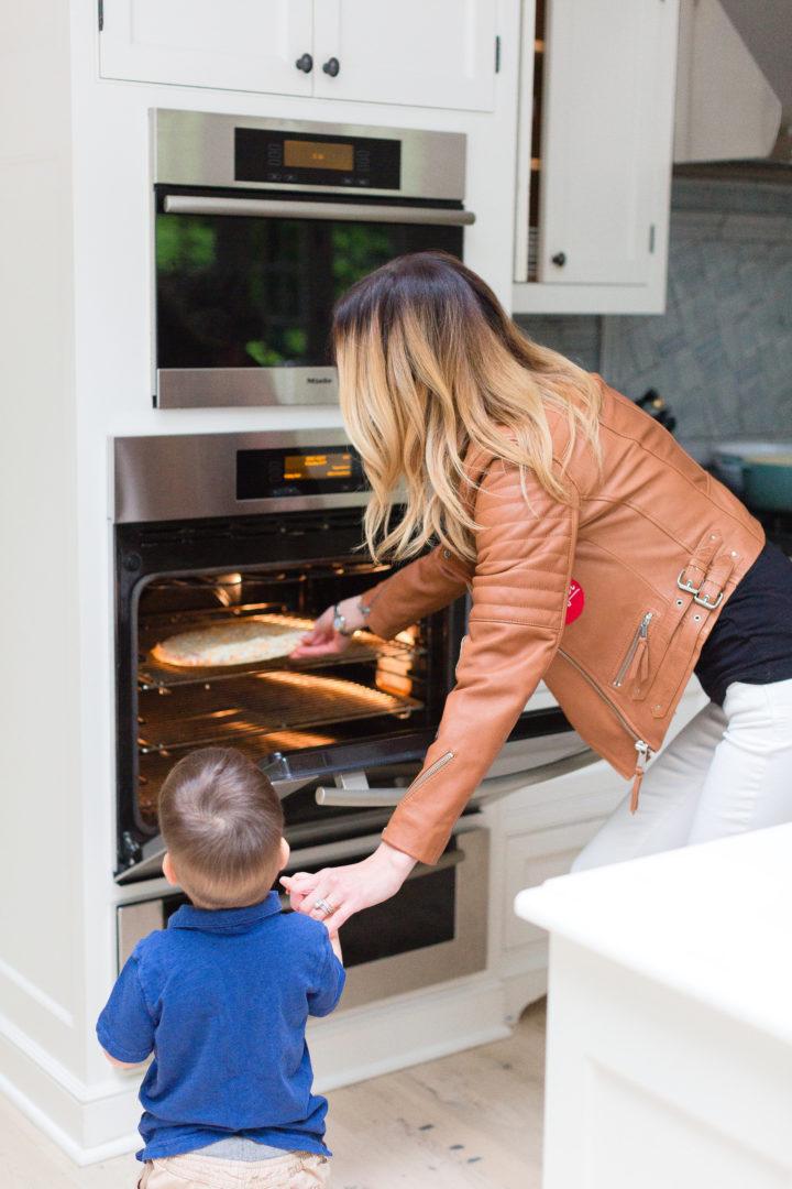 Eva Amurri Martino puts a Red Baron pizza in the oven