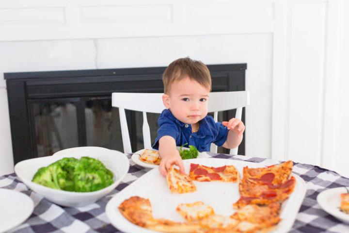 Eva Amurri Martino's son Major reaches for a slice of Red Baron pizza