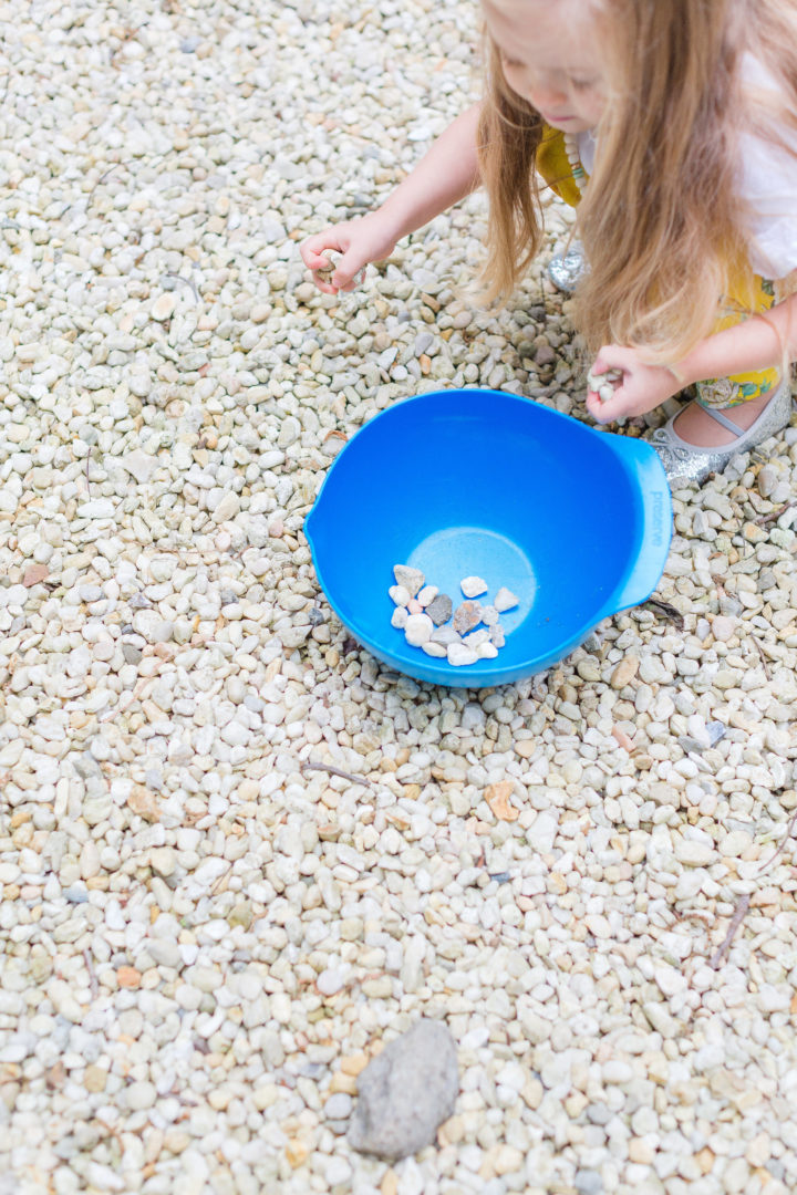 Eva Amurri Martino's daughter Marlowe collects rocks in the backyard of her Connecticut home.