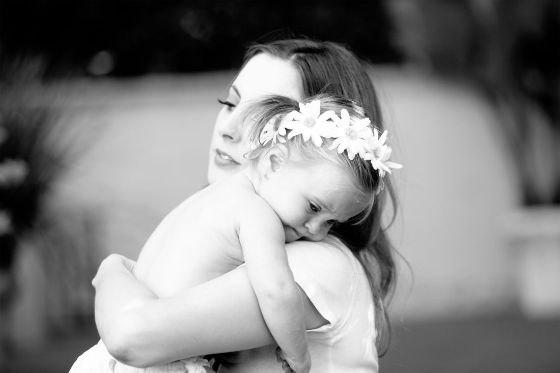 Eva Amurri Martino holds toddler daughter Marlowe in her arms in the yard of their sherman oaks home