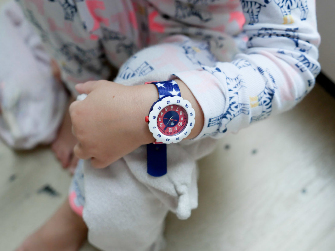 Marlowe Martino wears a fourth of july themed flik flak watch