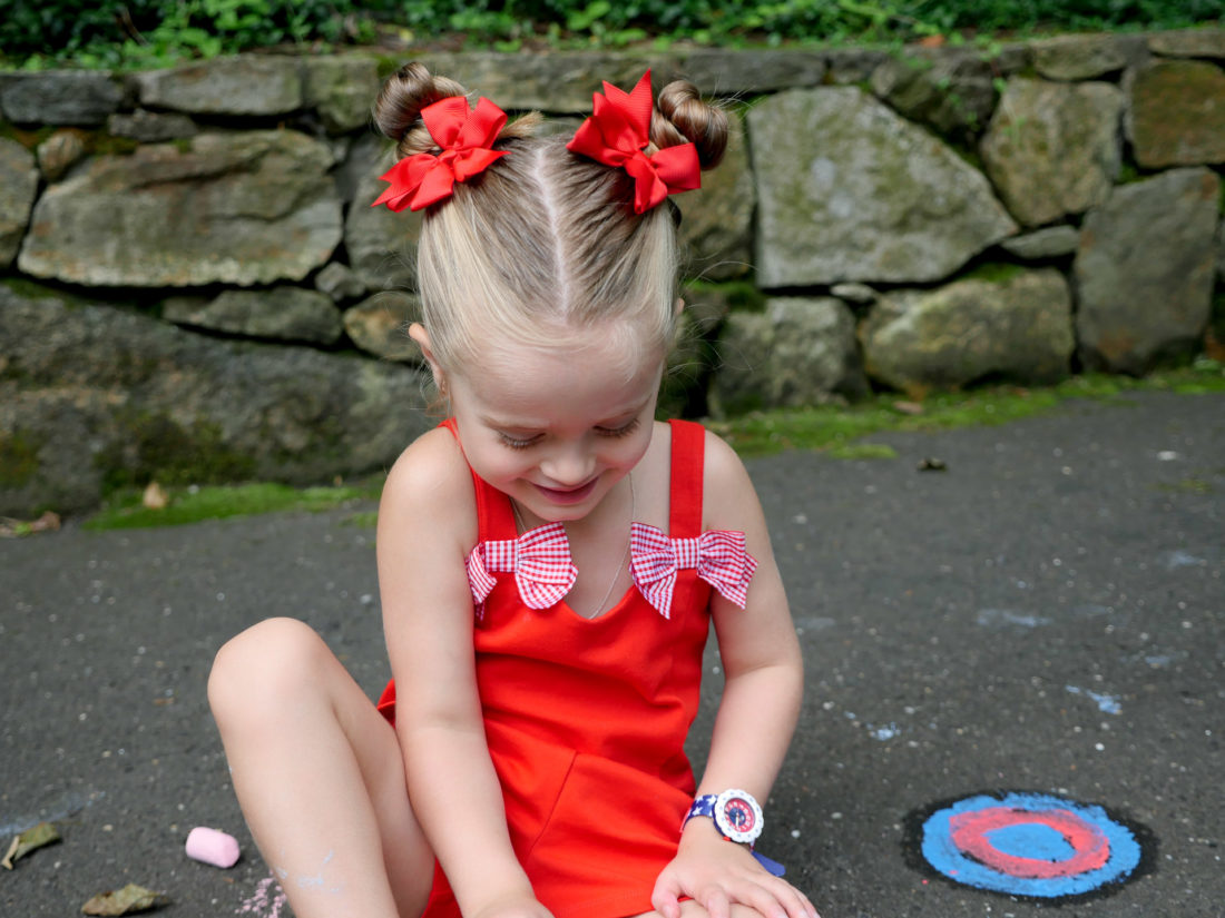 Marlowe Martino wears a red Janie and Jack romper for the fourth of july