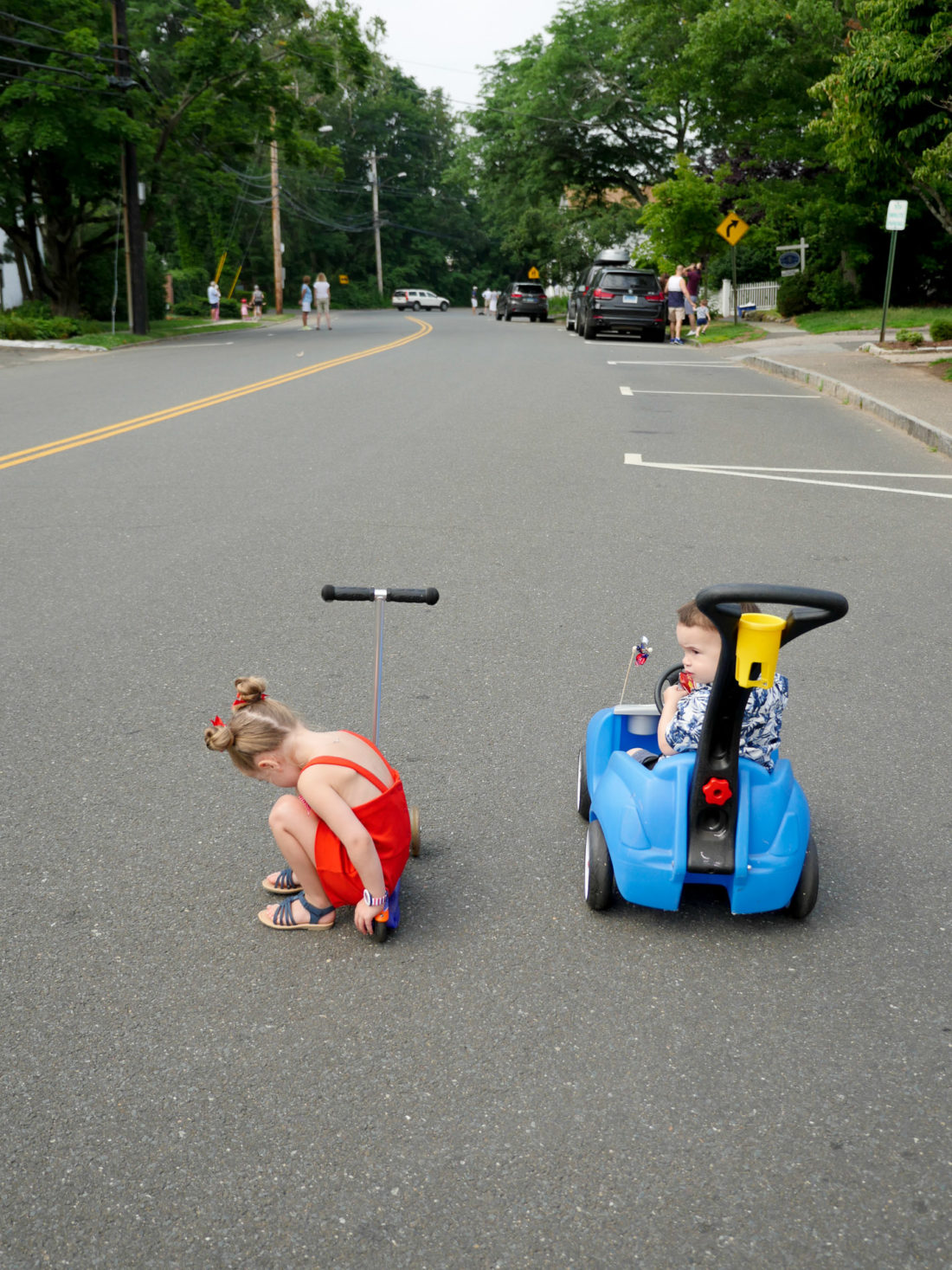Marlowe and Major Martino ride their scooter and car on the fourth of july