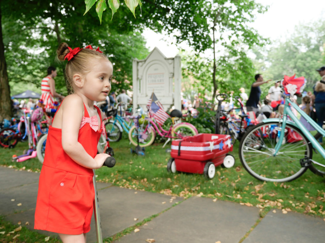 Marlowe Martino arrives at the kids' fourth of july bike parade in Southport, CT