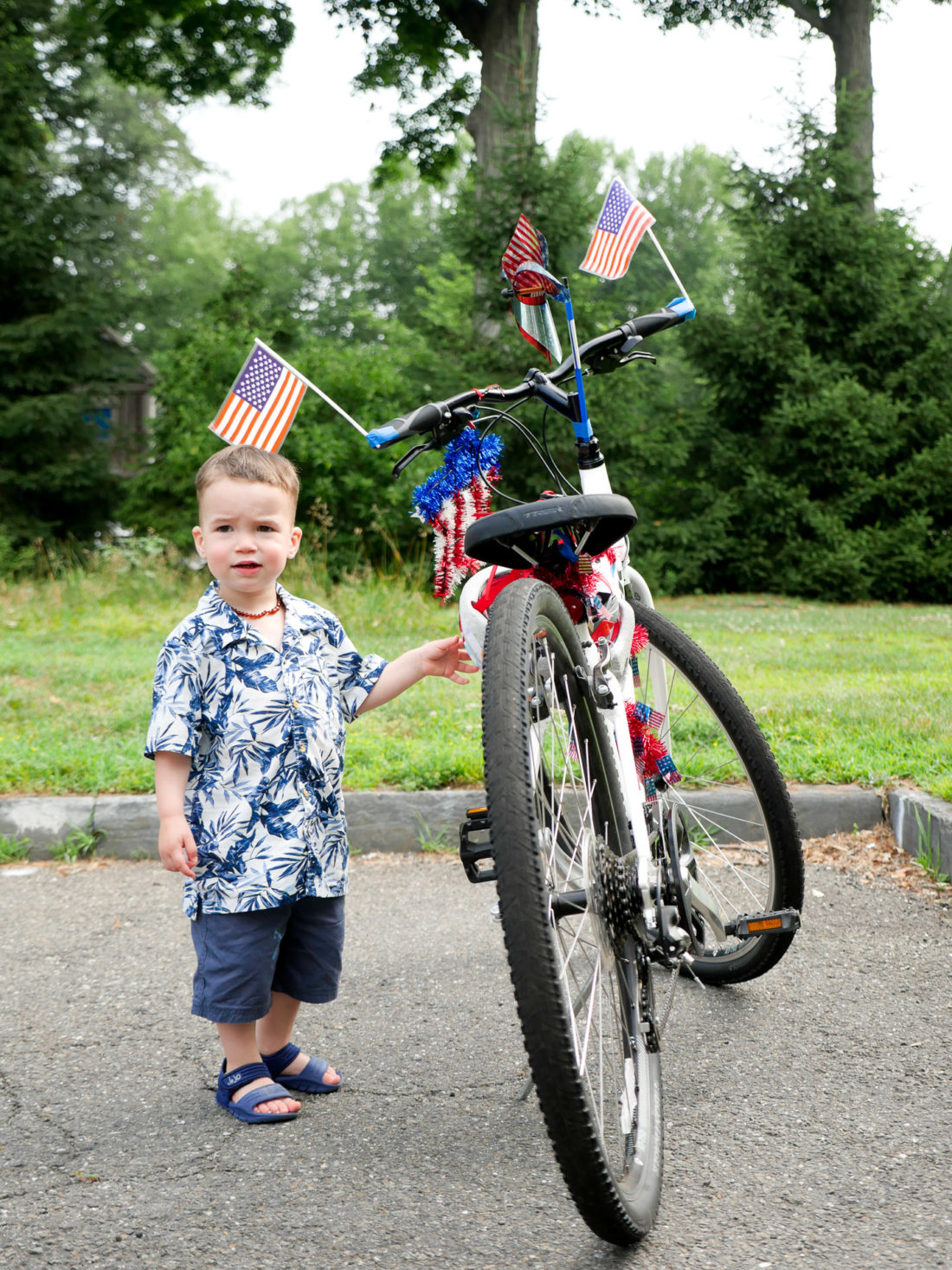Major Martino admires a festively decorated fourth of july bike at a party in Connecticut
