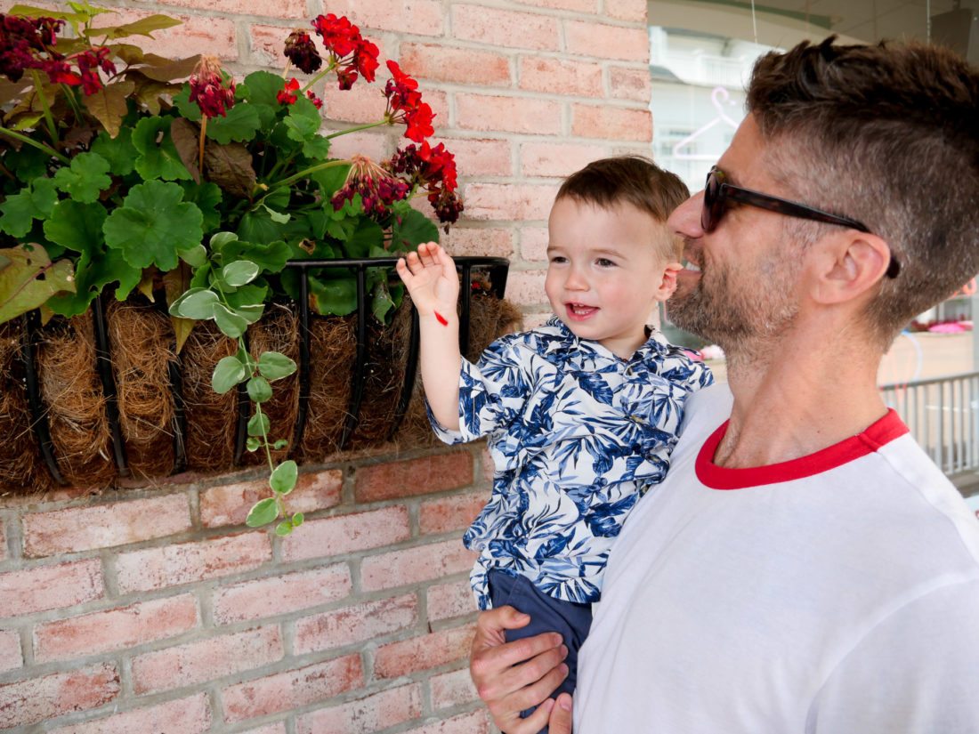 Kyle Martino holds Major Martino on the fourth of july in Connecticut