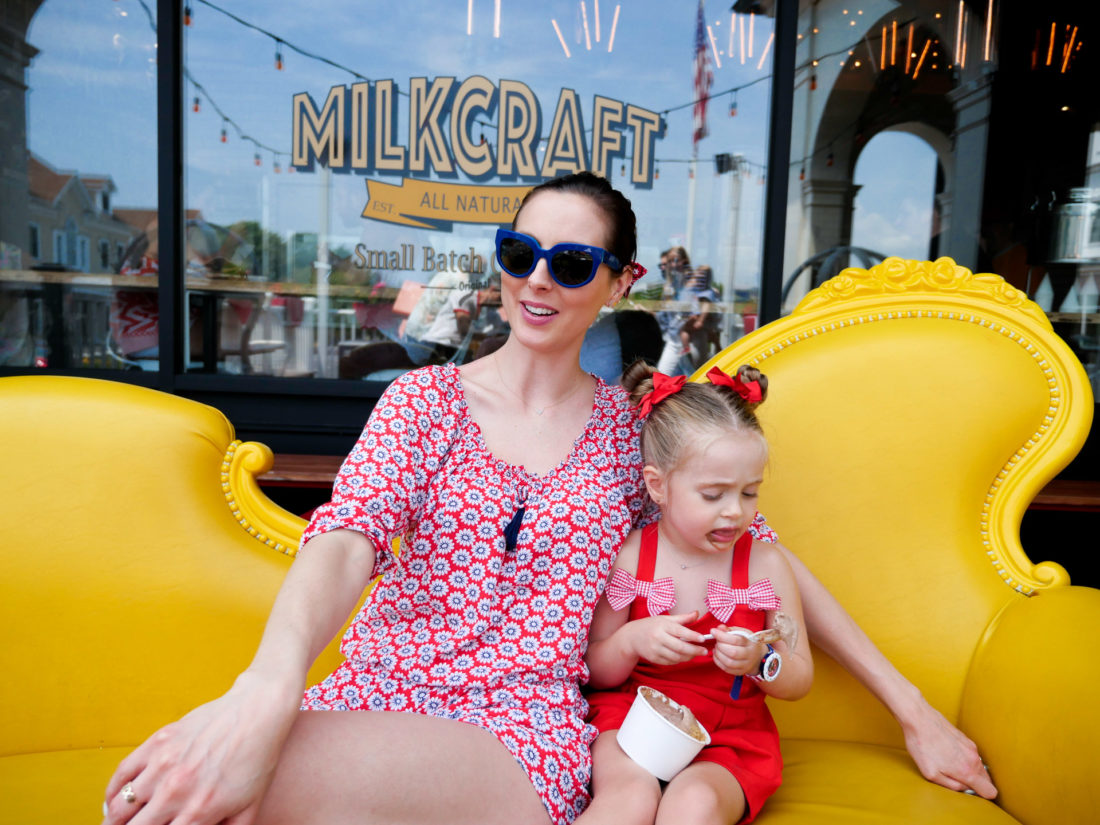 Eva Amurri Martino sits with Marlowe Martino outside of Milkcraft in Connecticut on the fourth of july
