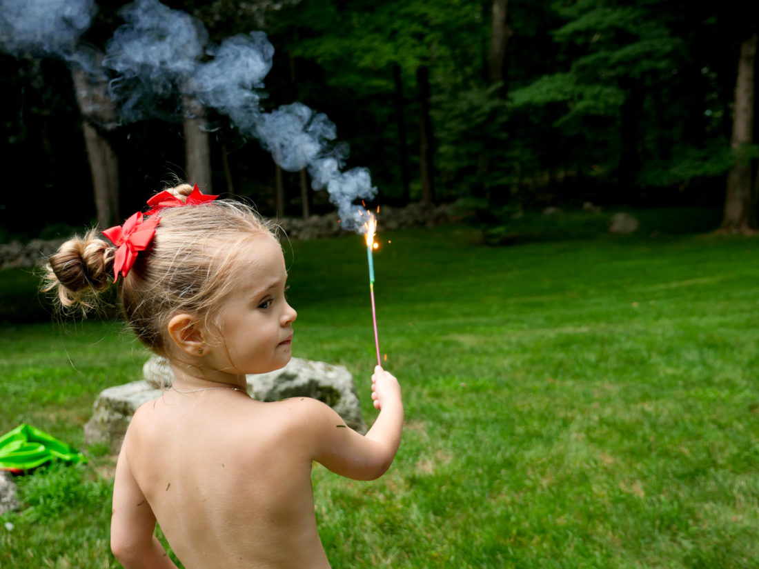 Marlowe Martino holds a sparkler on the fourth of july
